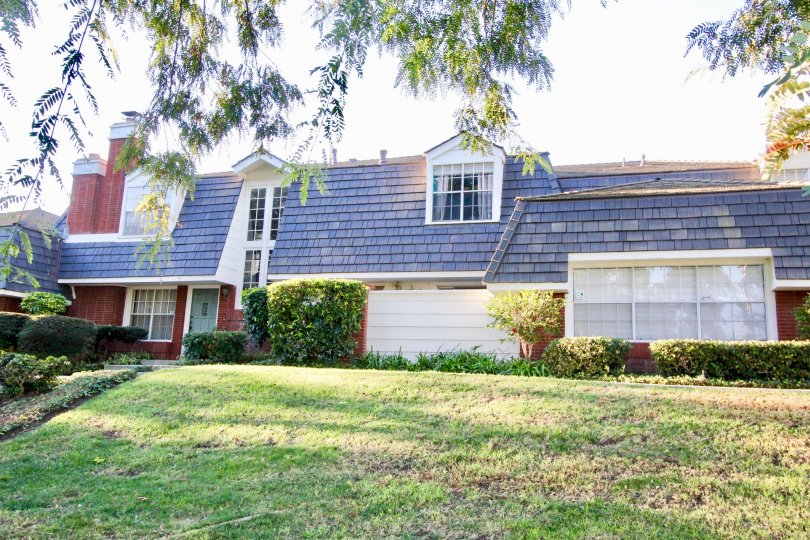 A two-storey townhouse in the Woodbridge Estates community with blue roofing.
