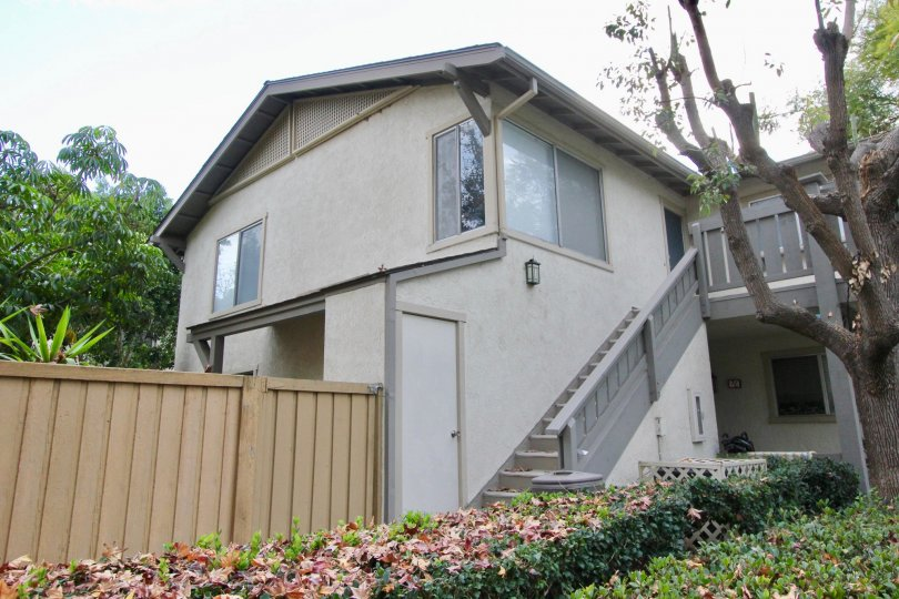 Two story condo homes with gray attached stairway in Woodbridge Reserve in Irvine CA
