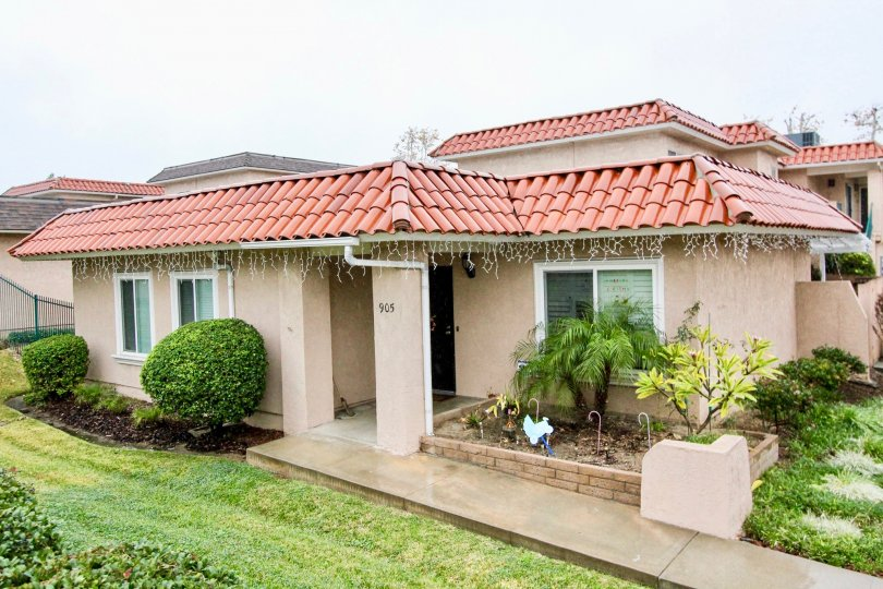 THE SMALL HOME WITH BEAUTIFUL LAWN, SMALL PLANTS, NUMBER ON THE WALL, ARE IN LA HABRA CITY
