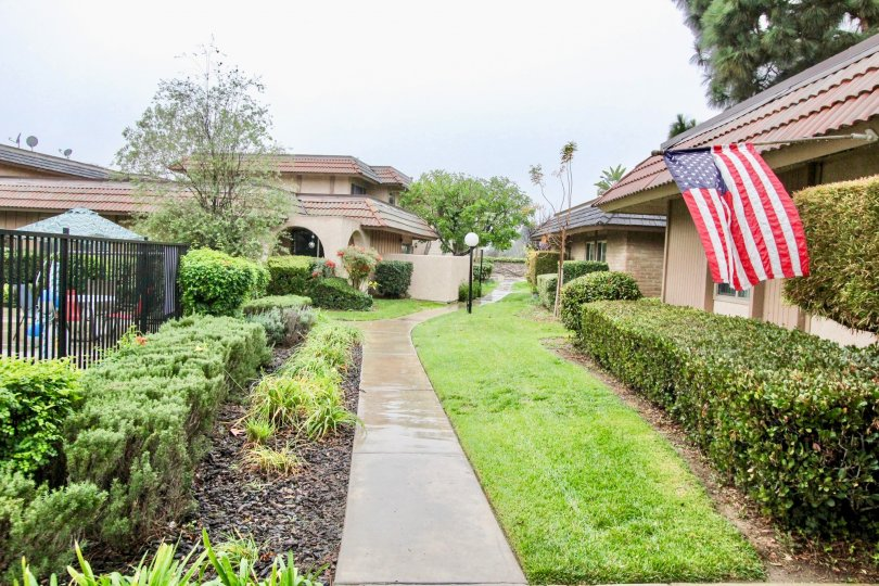 Fabulous view lawn and garden with USA Flag between villas in Fashion Walk of La Habra