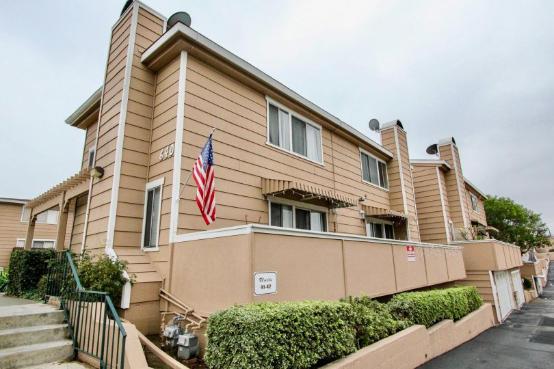 THE FLATS WITH FLAG, NUMBER ON THE WALL, FRONT PLANTS, ROADWAY ARE THERE IN LA HABRA CITY