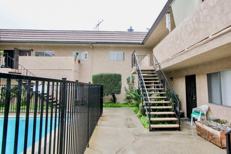 Stairs leading to the enclosed pool at the La Venezia community in La Habra