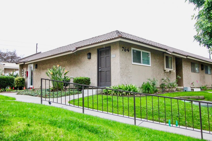 THIS IMAGE SHOWS THE HOME WITH BEAUTIFUL LAWN, PLANTS, NUMBER ON THE WALL ARE THERE IN LA HABRA CITY