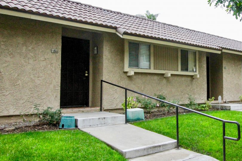 THE ENTRANCE OF THE HOUSE ON BOTH SIDE BEAUTIFUL LAWN IS THERE IN MIRA VISTA COMMUNITY