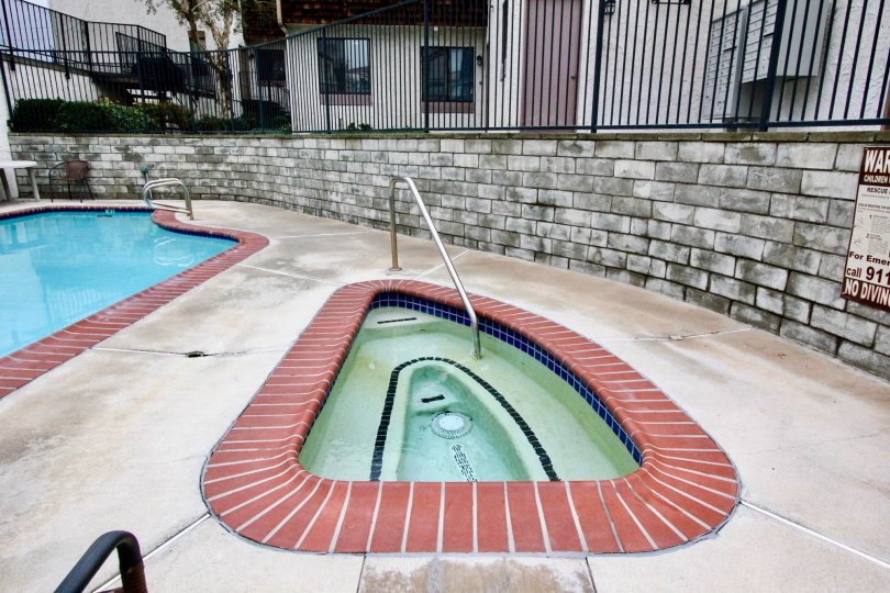 Swimming pool area with clean water and kids pool in Parkside Townhomes of La Habra city of california