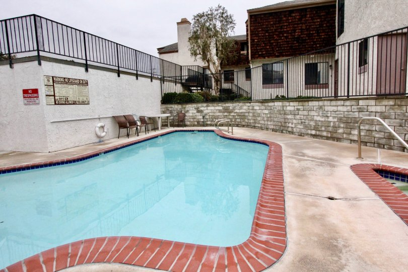 Swimming Pools are present in the Parkside Townhomes with seating chairs for both child's and adult's
