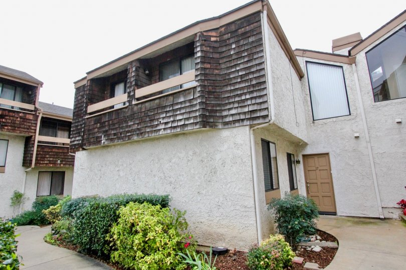Beautiful villa with glass window panes and small garden in Parkside Townhomes of La Habra