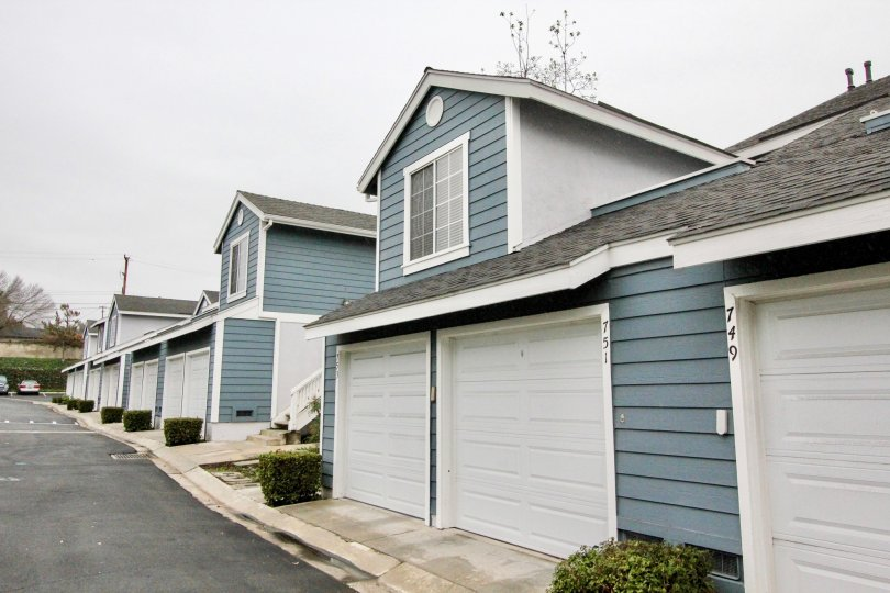 THE 751, 749 FLATS IN THE STONE HARBOR WITH THE SHUTTERS, PLANTS