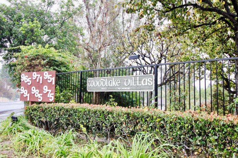 Greenish park near villas having name plate in Woodlake Villas of La Habra