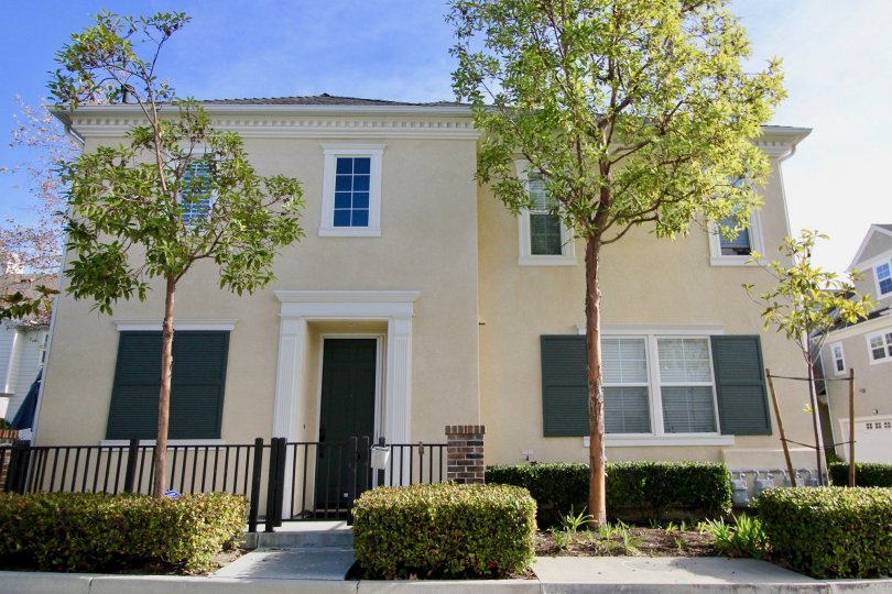 A cream colored two story home in Aldenhouse community in Ladera Ranch, California.