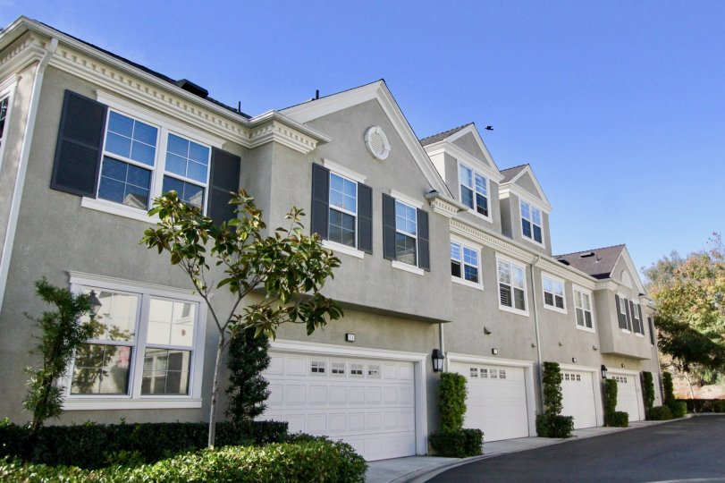 Front view with two car garages and plenty of windows at Aldenhouse in Ladera Ranch, California