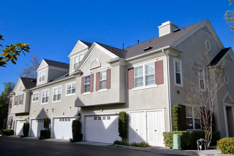 Blue skies and row of homes at Aidenhouse in Ladera Ranch, CA