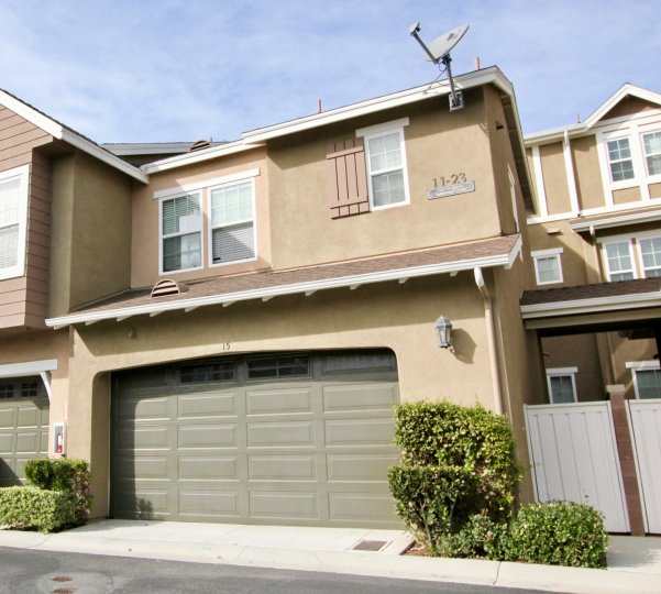 A brown home with a grey garage in Branches community in Ladera Ranch, California.