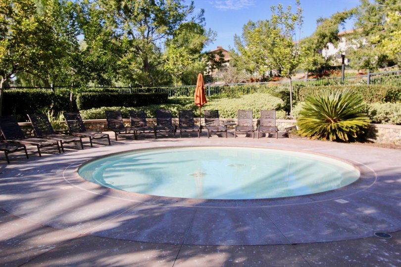 Chairs and pool at the Castellina in Ladera Ranch, CA