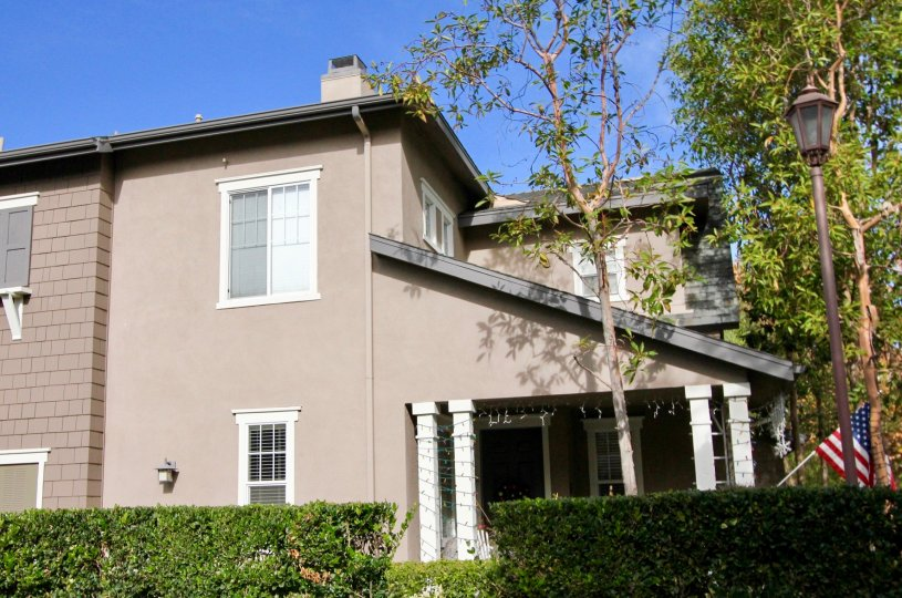 Good looking villa with street lamps and small garden with USA Flag in Chambray of Ladera Ranch