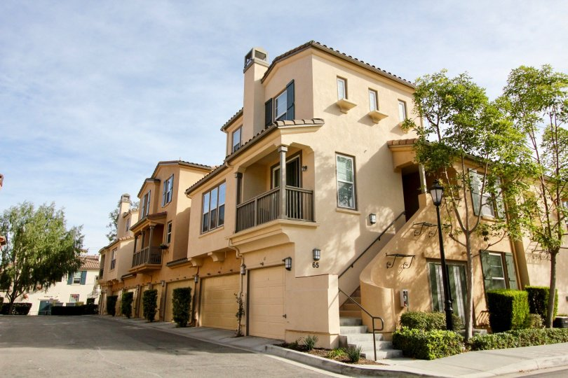 Outside view of a stairwell and front entrances of condos in Sansovino, Ladera Ranch, California