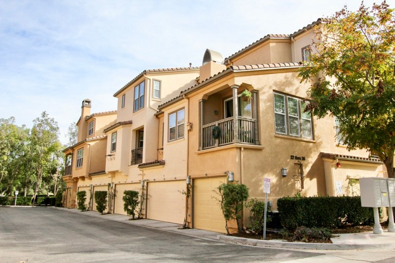 Several beautiful tan homes in the Sansovino community in Ladera Ranch, California.