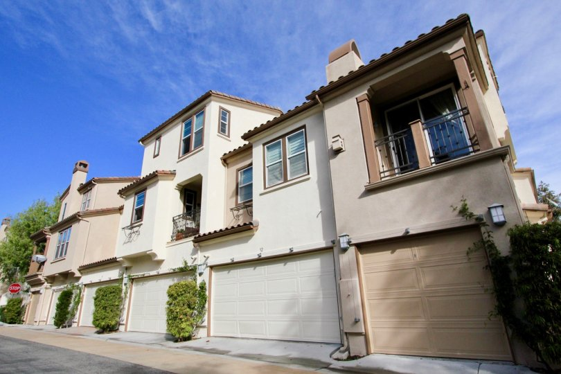 A tan homes with garages in Sansovino community in Ladera Ranch, California.