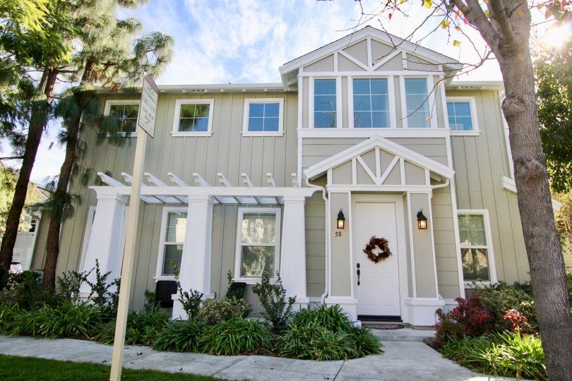 The outside view on a sunny day of a target on home showing the front of the house and walkway in Ladera ranch