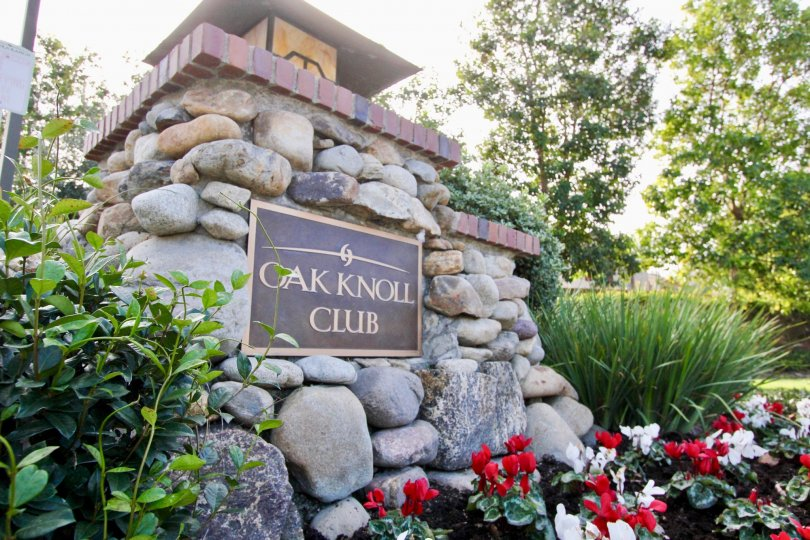 Oak Knoll Club's beautiful stone entrance sign and landscape