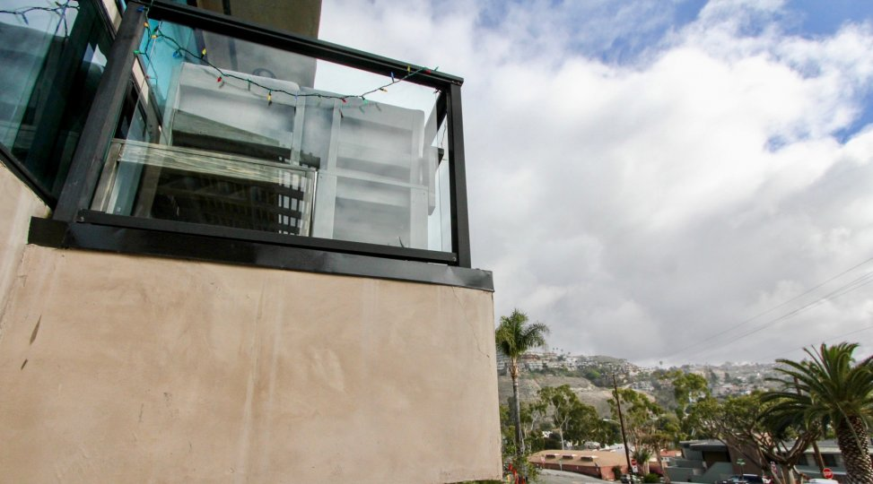 a warm day in the 174 cliff drive with a building that has glass wall