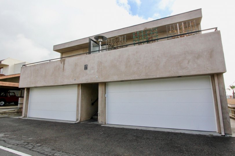 Cloudy sky with garages at 174 Cliff Drive in Laguna Beach, CA.