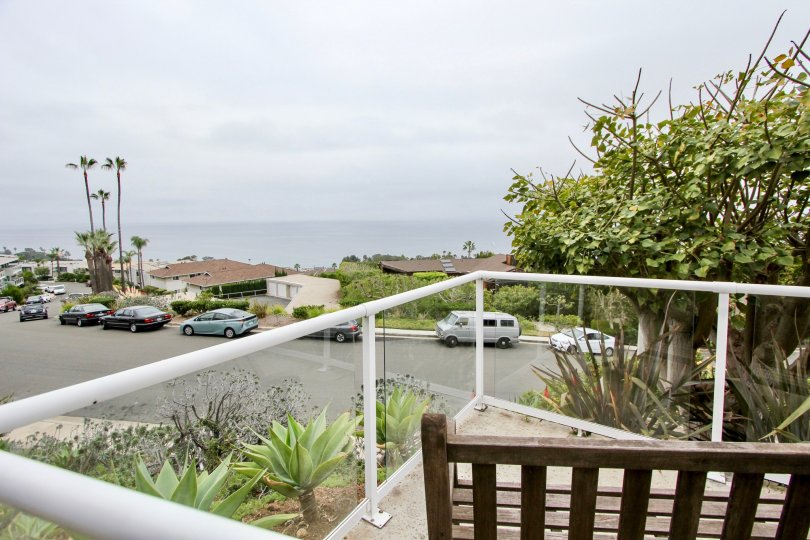 A view of a Aliso Laguna street, from a home's second floor balcony.