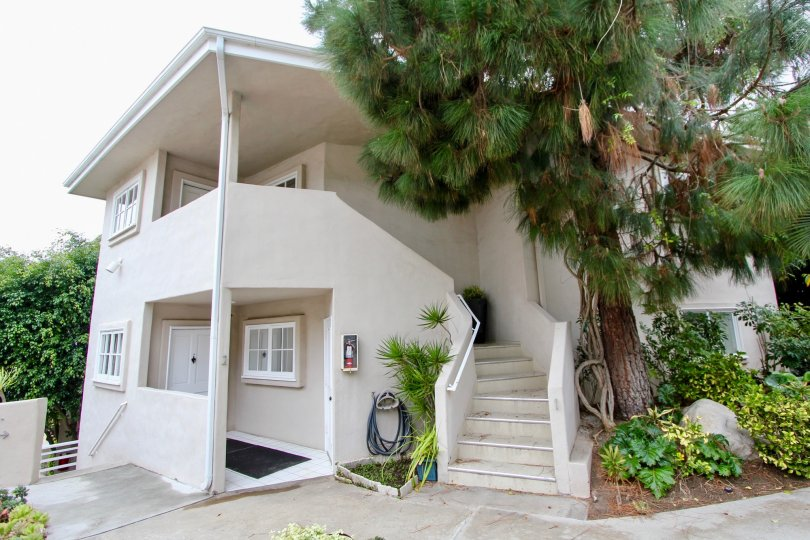 Side view with front open space and staircase of Coast Royal community, Laguna Beach, CA