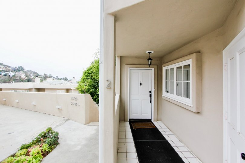 Cloudy sky with a front porch and door in the Creekside Community in Laguna Beach, CA.