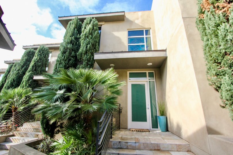 A two-storey townhouse with modern doors and windows in the Crescent Bay Villas neighborhood.