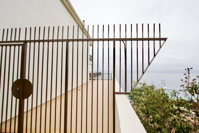 Metal fence overlooking the beach in Laguna Royale, Laguna Beach, California