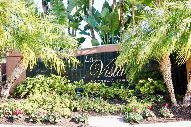 THE VILLAS WITH THE LA VISTA CONDOMINIUMS WALL, PLANTS, TREES
