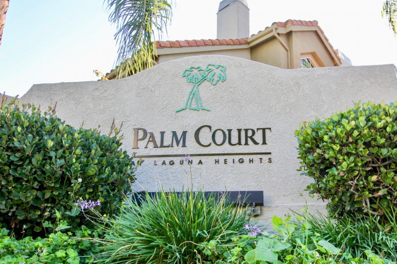 Plants and front sign at Palm Court in Laguna Niguel, CA
