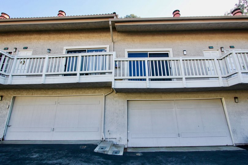 A sunny day in the area of Rancho Niguel, outside, condos, balcony, railing, chimney, doors, garages