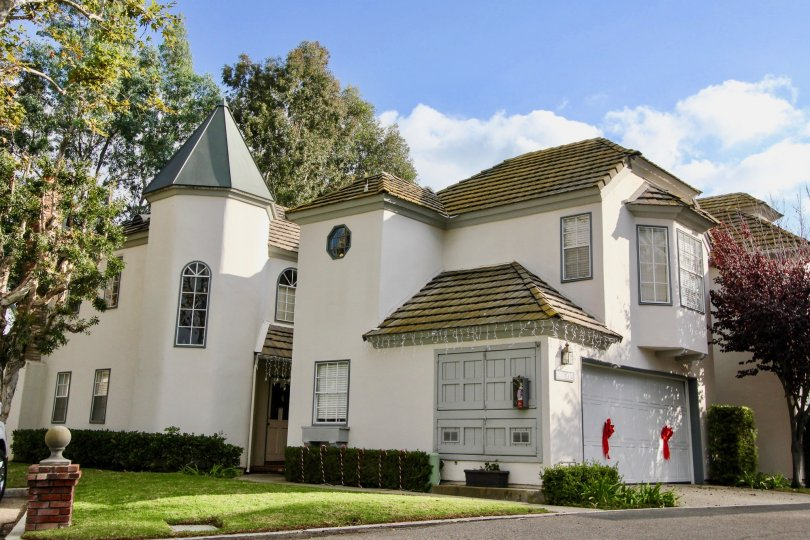 A beautigul home with tiled roof, and a turret and a nice lawn in the community of Villa De Cerise in Laguna Niguel, California