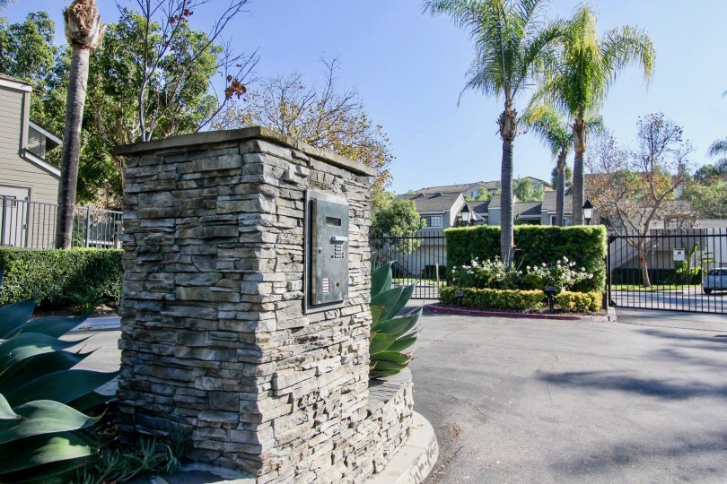 Villa point with gate and palm trees in Village Niguel Terrace I of Laguna Niguel