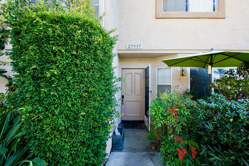 Hedges and front door at Village Niguel Terrace II at Laguna Niguel, CA