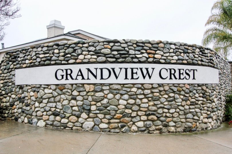 Circular multi-colored stone wall surrounding Grandview Crest in California.