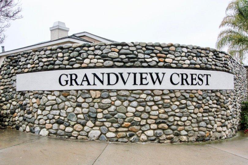 Circular multi-colored stone wall surrounding Grandview Crest in California.
