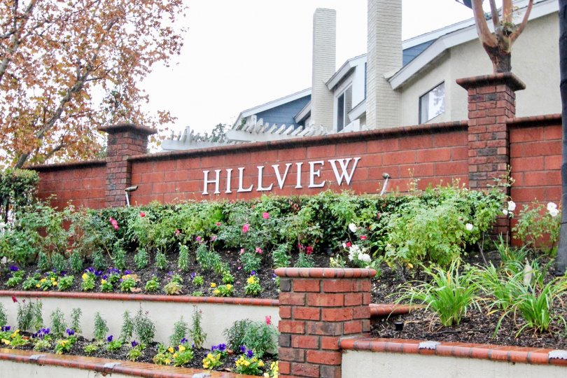 Two white brick chimneys sit high above townhomes in the Hillview community