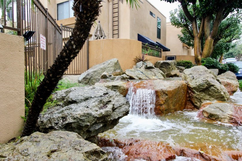 A pond with mini-waterfalls in the Le Parc community.