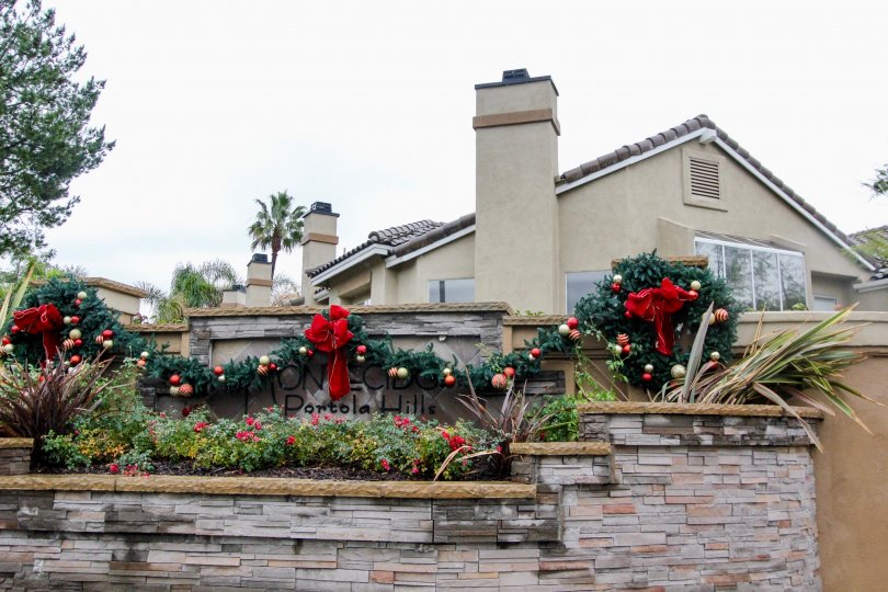 Holiday is in the air at the Montecido, Lake Forest graced by the wreath and flowers.