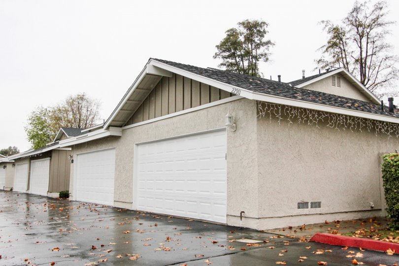 Many garages with a wet ground with leaves on it in Richwood community in Lake forest, California.
