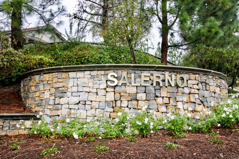 A stone welcome sign at the Salerno in Lake Forest, CA