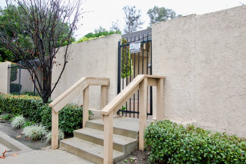 Excellent entrance gate with grill and steps in Serrano Creek Villas of Lake Forest