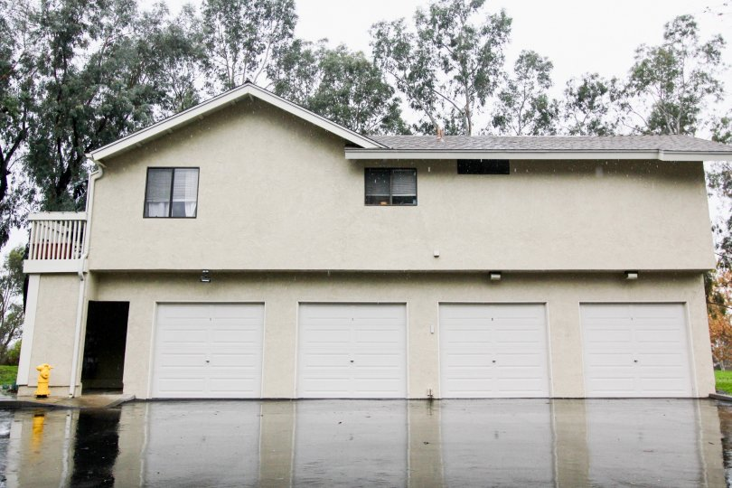 View of four single car garages and fire hydrant at Sycamore Glen in Lake Forest, California