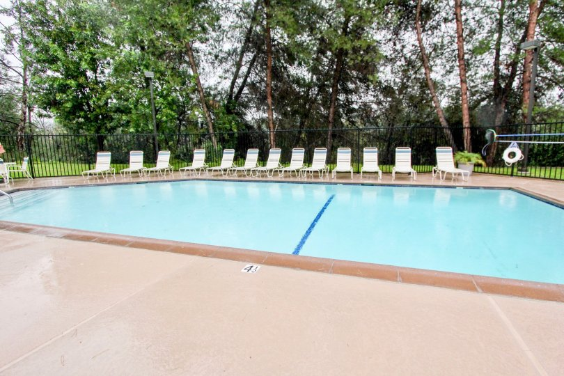 A pool with chairs around in at Sycamore Glen community in Lake Forest, California.