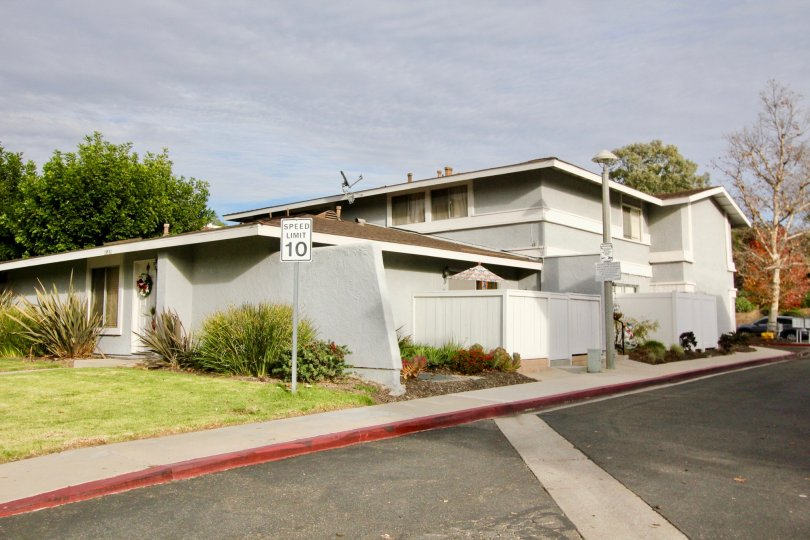 Grey color home with beautiful lawn and sloped roof in Aliso Villas.