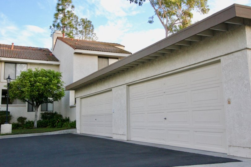 A large home in Mission Viejo, CA with two garages, a tree, and two floors.