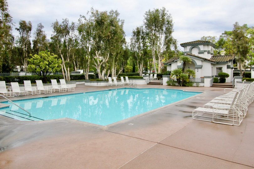 Three stairs and a railing provide access to the community pool in the Mirasol community.